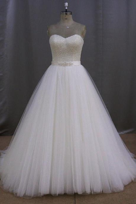 Strapless Sweetheart Tulle Princess Ball Gown Featuring Sparkly Beading Embellishment